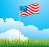 USA flag in yard. USA flag blowing in wind outside Royalty Free Stock Photography