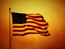 USA flag on yellow backdrop Royalty Free Stock Photo