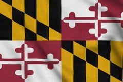 USA flagga av Maryland som vinkar f?rsiktigt i vinden stock illustrationer