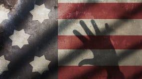 USA-flagga med porten och handen Arkivbild