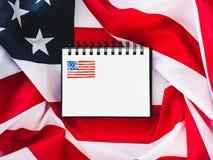 USA-flagga och tom sida royaltyfri bild