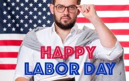 USA flaggan och den lyckliga läraren man lycklig arbets- dag royaltyfri bild