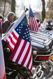 USA Flags are displayed at the back of motorbike on Czech Motor season opening. royalty free stock image