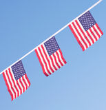 USA flags hanging proudly for July 4 Independence Day Stock Photography