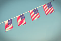 USA flags hanging prowdly for July 4 Independance Day Royalty Free Stock Photo