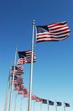 USA flags in a row. Against blue sky Stock Image