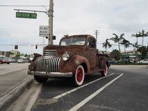 1941 Chevy AK pickup truck with simulated rust paint on parking lot