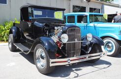 Black Custom rod based of 1929 Ford model A, another model A in blue on the background