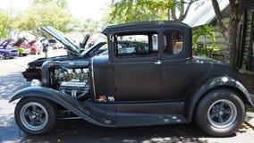 Mate black Custom rod based of 1929 Ford model A side