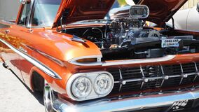 Shiny orange lowrider with big chromed engine