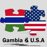 USA and Gambia flags in puzzle Stock Photos