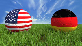 USA-Germany. 3D soccer balls with usa and germany flag, world football cup 2014. Palaced on 3d grass. Background  with clipping path Royalty Free Stock Photography
