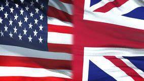 USA and Great Britain officials exchanging confidential envelope, against flags. Stock footage stock footage