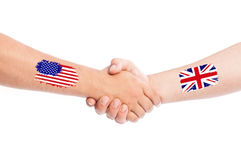 USA and Great Britain shaking hands Stock Photos