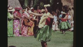Hula Dancers And Musicians Performing. USA, HAWAII, HONOLULU APRIL 1977. Two Shot Sequence Of Hula Dancers In Traditional Ti Leaf Skirts, Dancing And An All stock video