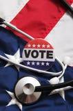 USA Heath Voting Pin på flagga arkivbild