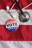 USA Heath Voting Pin på flagga royaltyfri fotografi