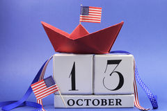 USA holiday, Happy Columbus Day, for the second Monday, 13 October celebration Save the Date calendar. With a red paper boat and stars and strips flags and royalty free stock photo