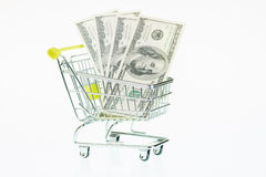 USA hundra dollarräkningar i shoppingvagn Fotografering för Bildbyråer