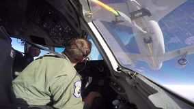 USA IDAHO, NOVEMBER 2015, A Tanker Aircraft Flying Filmed Out Cockpit. A aircraft fly in position of the back of a tanker aircraft. The shot is take out of the stock footage