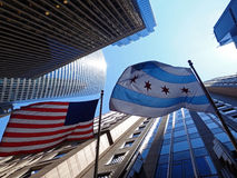 USA & Illinois Flag. Illinois flag in downtown Chicago in vanishing point of view Stock Image