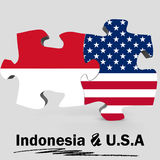 USA and Indonesia flags in puzzle Stock Photos