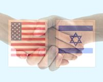 USA and Israel flag with handshake. On blue royalty free stock image