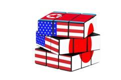 USA, Japan and North Korea flag puzzle shape. Isolated on white background royalty free stock photo