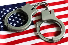 Usa legal system concept, handcuffs on background and american flag Royalty Free Stock Photography