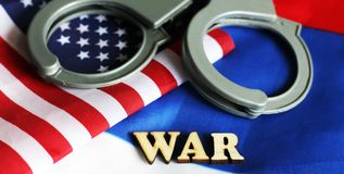 Usa legal system concept, handcuffs on background and american flag Royalty Free Stock Photos