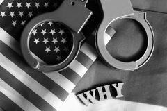 Usa legal system concept, handcuffs on background and american flag Stock Images