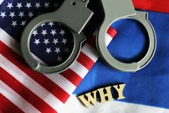 Usa legal system concept, handcuffs on background and american flag Stock Photos