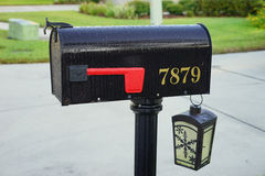 A USA mail box and a solar light Stock Image