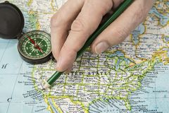 USA map with pencil pointing on various us city. stock photos