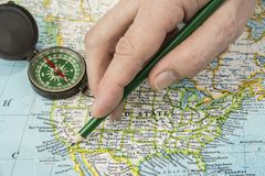 USA map with pencil pointing on various us city.  stock photography
