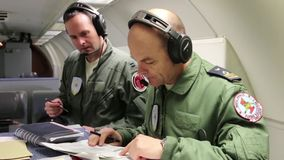 USA, MARCH 2017, Soldiers on aircraft checking papers. Two soldiers on board of a aircraft checking some papers stock video