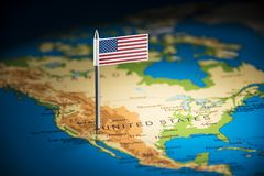 USA marked with a flag on the map.  royalty free stock photo