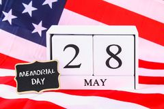 USA Memorial Day concept with calendar and red remembrance poppy. On American stars and stripes flag Stock Photos
