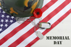 USA Memorial Day concept. USA Memorial Day concept with dog tags and red remembrance poppy on American stars and stripes flag on white vintage wood table with Stock Photography