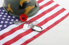 USA Memorial Day concept. USA Memorial Day concept with dog tags and red remembrance poppy on American stars and stripes flag on white vintage wood table with Royalty Free Stock Images
