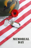 USA Memorial Day concept. USA Memorial Day concept with dog tags and red remembrance poppy on American stars and stripes flag on white vintage wood table with Royalty Free Stock Image