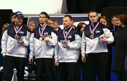 USA Men's Curling Team. John Shuster, Jason Smith, Jeff Isaacson, and John Benton,   pose with their medals after they defeated Team Tyler George during the Men' Stock Photos