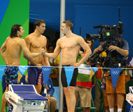 USA Men's 4x100m medley relay team Cory Miller (L), Michael Phelps and Ryan Murphy celebrate victory. RIO DE JANEIRO, BRAZIL - AUGUST 13, 2016: USA Men's 4x100m stock images