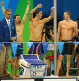 USA Men's 4x100m medley relay team Cory Miller (L),  Michael Phelps  and Ryan Murphy celebrate victory Royalty Free Stock Photo
