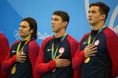 USA Men's 4x100m medley relay team Cory Miller (L),  Michael Phelps and Nathan Adrian celebrate victory Stock Photography