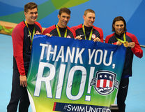 USA Men's 4x100m medley relay team Nathan Adrian(L),  Michael Phelps, Ryan Murphy and Cory Miller celebrate victory Royalty Free Stock Photos