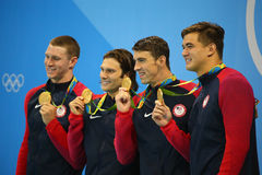 USA Men's 4x100m medley relay team Ryan Murphy (L), Cory Miller,  Michael Phelps and Nathan Adrian Stock Photography