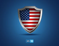 USA metal shield on the blue background Royalty Free Stock Image