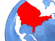USA on metallic globe with blue oceans. USA in red color on globe with watery oceans and shiny metallic landmasses. 3D illustration Royalty Free Stock Photography