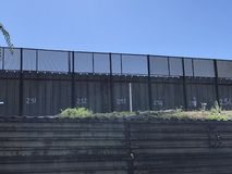 US - Mexican border wall in San Diego, CA. The USA Mexican border. The international border separating Mexico and the United States. The most frequently crossed stock photo
